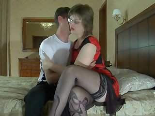 Gorgeous lady in stockings gave a young pan to fuck herself