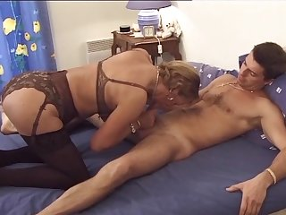 French governess in bed spread a young guy for sex, exposing big tits