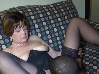 An old woman swallows a penis and gives it to a black man in a hotel room