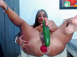 Fat woman fucked tight anal with a huge cucumber