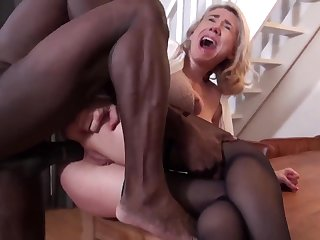 Interracial sex on the table with an elderly beauty